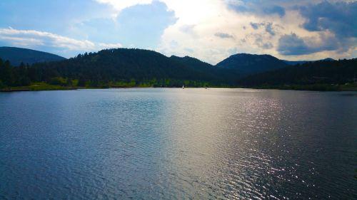lake sail boat sun