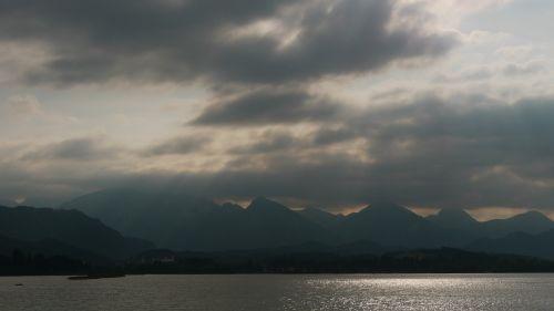 lake mountains clouds