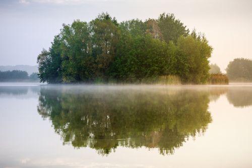 lake mirroring fog