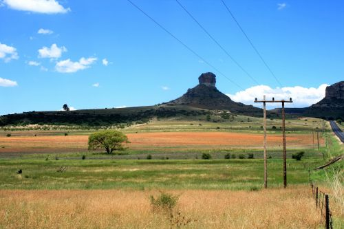 Landscape With Butte In Background