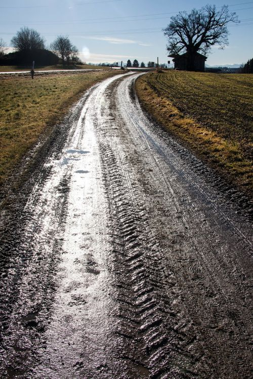lane tire tracks puddles