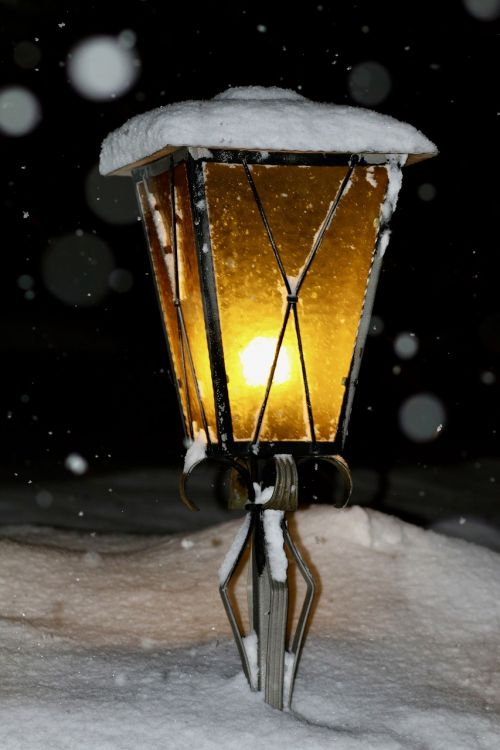 lantern light snowfall