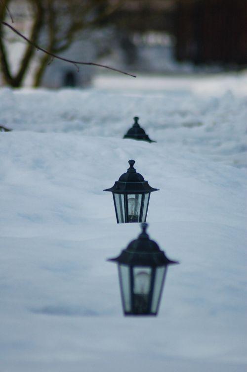 lanterns in deep snow depth of field winter landscape with lanterns