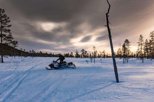 lapland polar winter snowmobile
