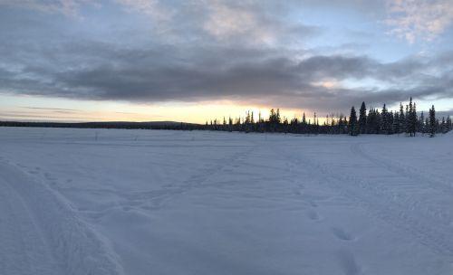 lapland the frozen lake sunset