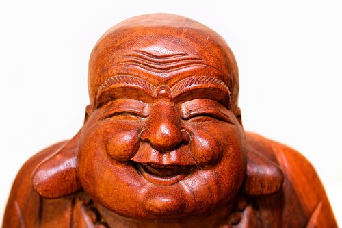 laughing buddha head  wooden  smile