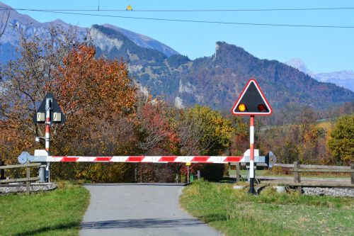 level crossing autumn mountains