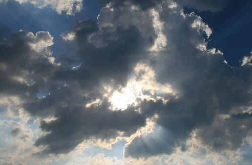 Light And Dark Clouds With Sun