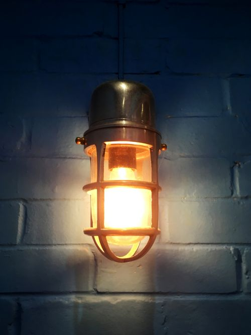 light bulb lamp blue wall