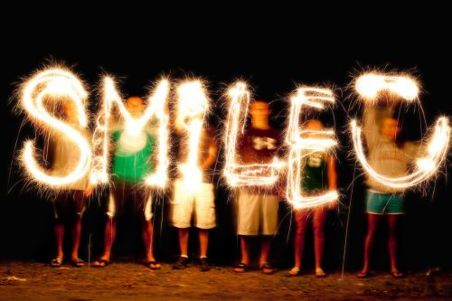 light painting sparkler writing fourth of july