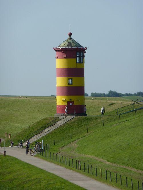 lighthouse dike sea