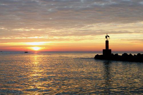 lighthouse mediterranean beach