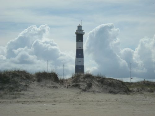 lighthouse loneliness beach cloud