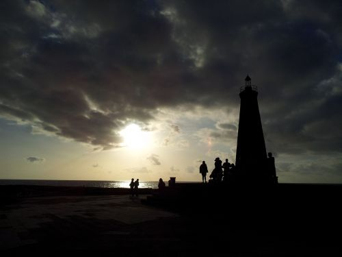 lighthouse silhouettes sunset
