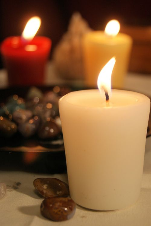 Lit Candles And A Bowl Of Rocks