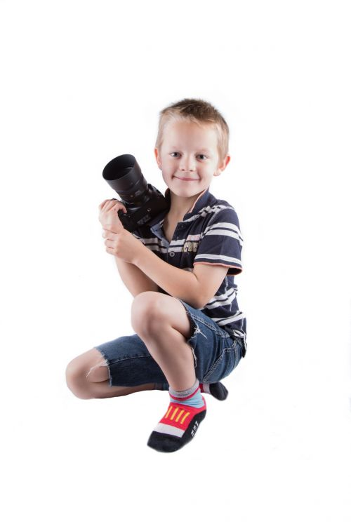 Little Boy With Camera
