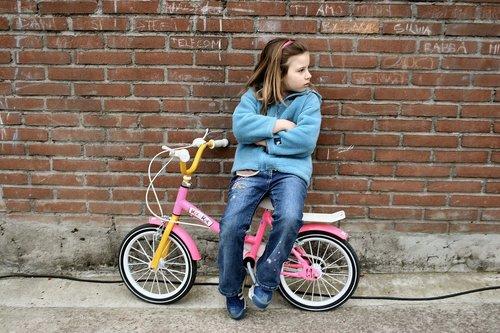 little girl  bicycle  boredom