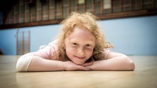 little girl gymnast hall happy