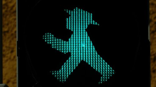 little green man traffic lights footbridge