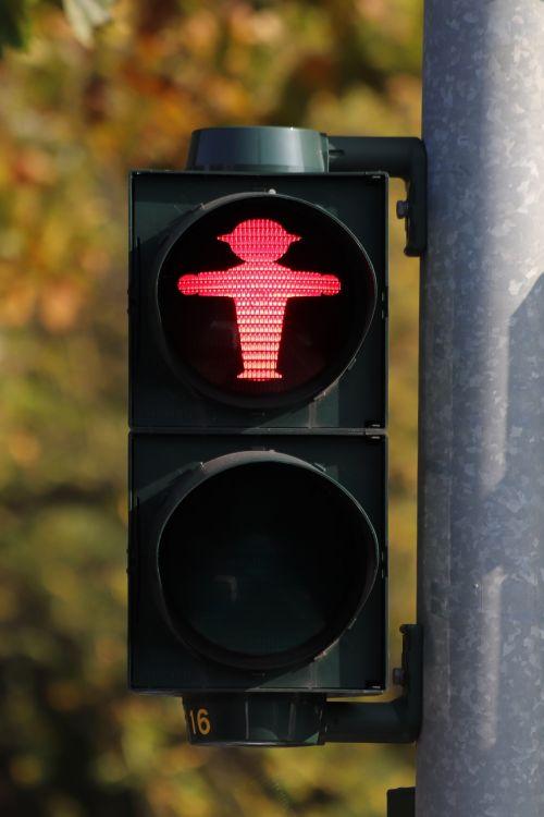 little green man traffic lights containing