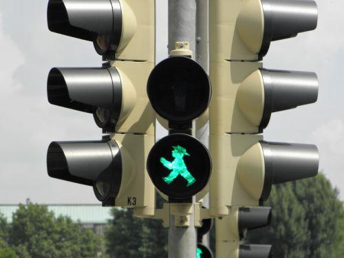 little green man traffic lights green