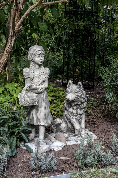 little red riding hood and wolf stone sculpture