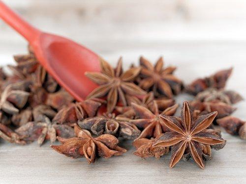 little spoon  wooden table  anise stars