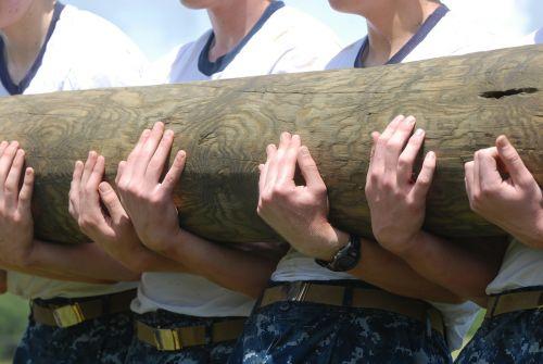 log holding men