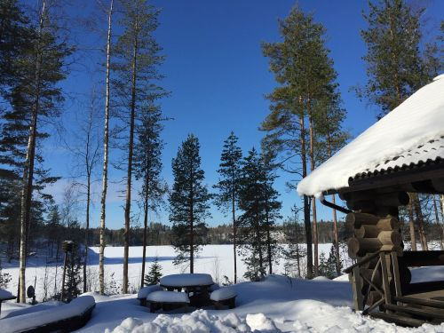 log cabin finland snow