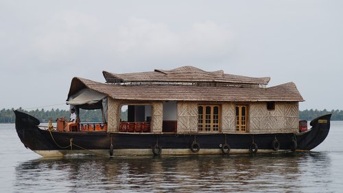 lone house  house on waters  kerala