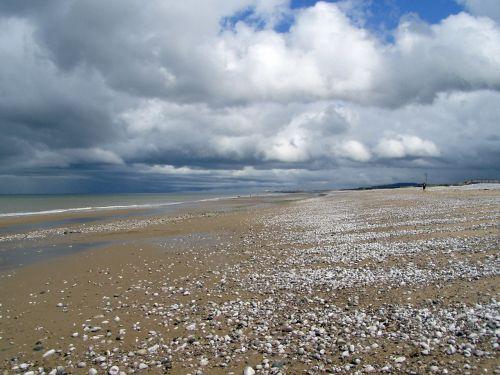 lonely beach beach clouds