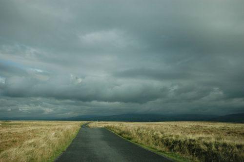 long road dark sky