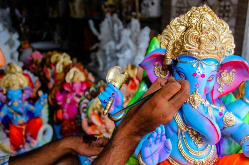 lord ganesh sculpting hinduism