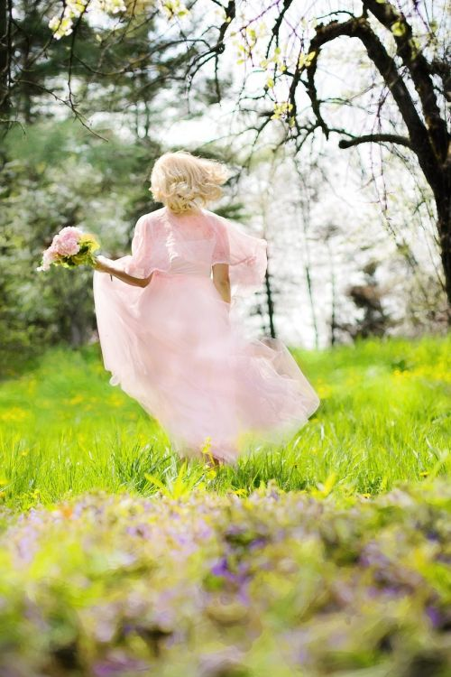lovely woman pink dress running
