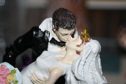 lovers bride and groom kiss