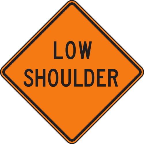 low shoulder road sign