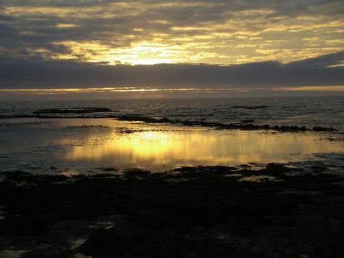low tide sunset clouds