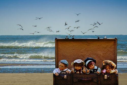 luggage dolls beach