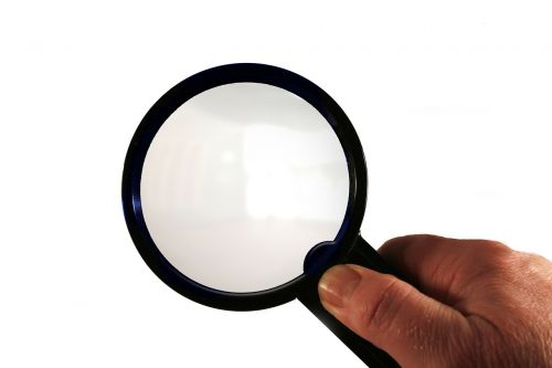 magnifying glass hand finger