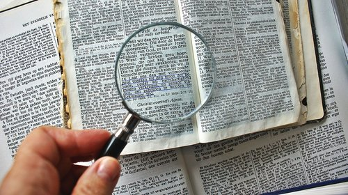 magnifying glass  to enlarge  book