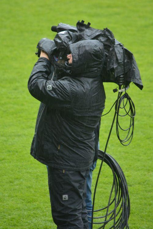man filming camera