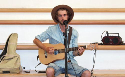 man singer guitar