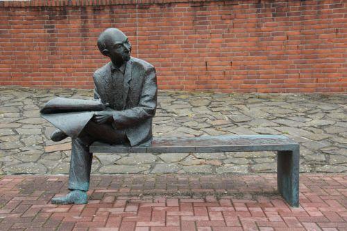 man newspaper read