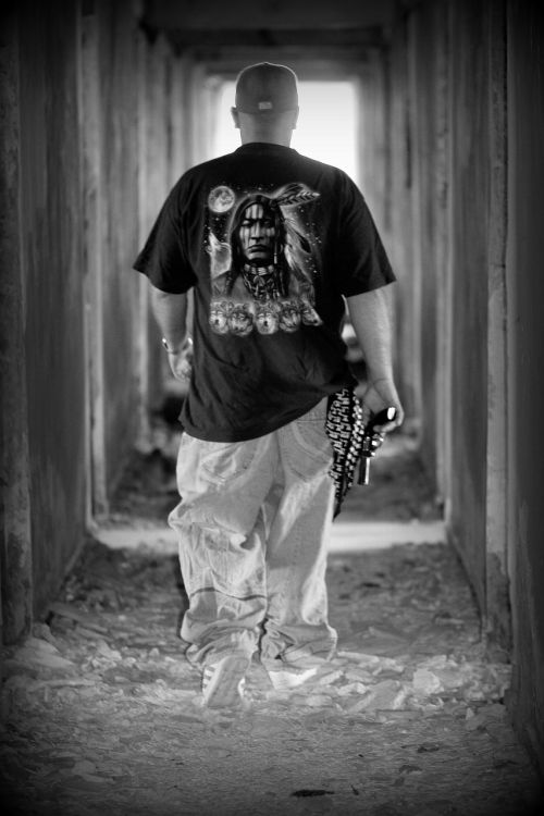 man gangster pistol