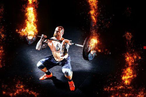 man muscles weightlifter