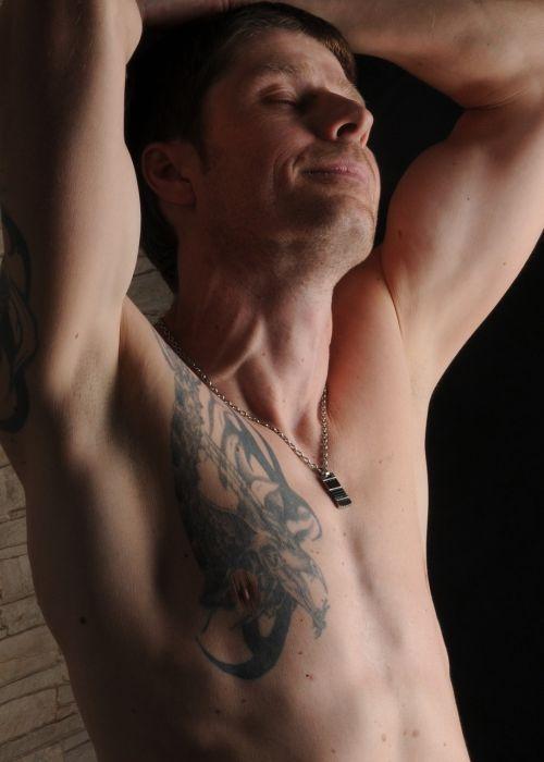 man muscles tattoo