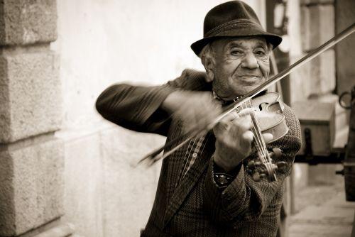 man violin street musicians