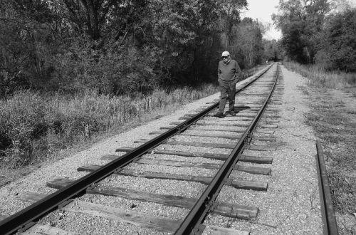 man walking railroad