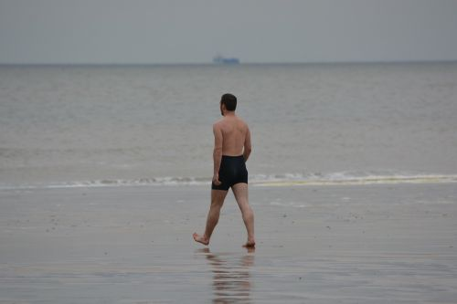 man swimming trunks sea