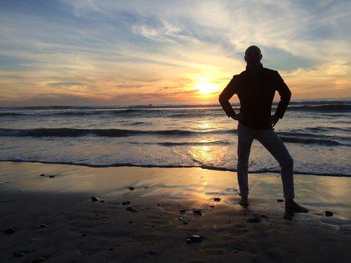 man  sunset  beach